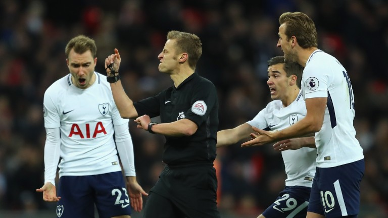 Christian Eriksen, Harry Winks and Harry Kane of Tottenham appeal to match referee Mike Jones during the Premier League match against West Brom
