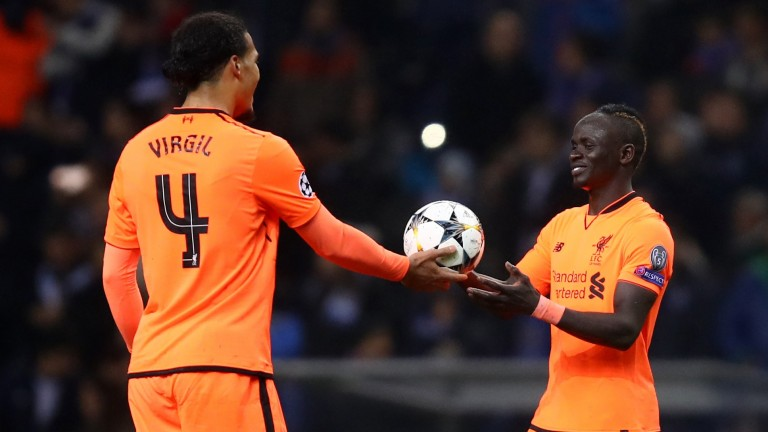 Sadio Mane receives the match ball from Virgil van Dijk after his first-leg hat-trick