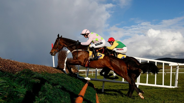 Douvan and Ruby Walsh (near side) in action at Punchestown