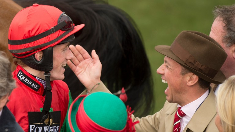 Frankie Dettori congratulates Sam Twiston-Davies after Dodging Bullets won the Champion Chase
