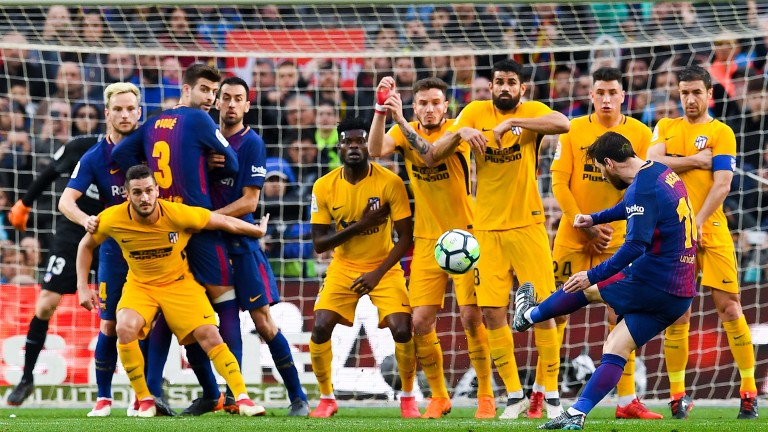 A sensational Lionel Messi free-kick gave Barcelona victory over Atletico Madrid