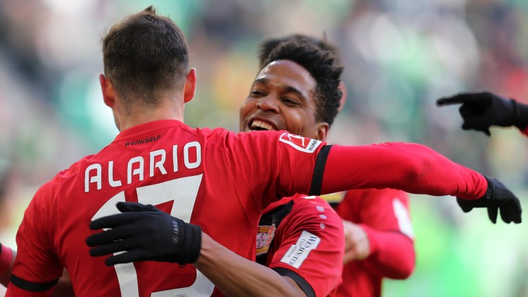 Lucas Alario and Wendell celebrate a Bayer Leverkusen goal against Wolfsburg