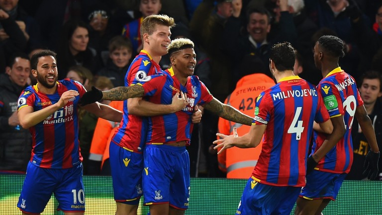 Crystal Palace celebrate after Patrick van Aanholt put them 2-0 up against Manchester United