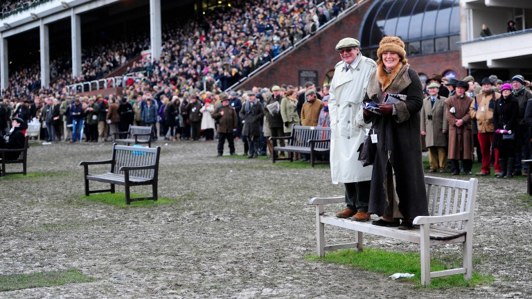 Racegoers are well prepared for a wet day at Cheltenham