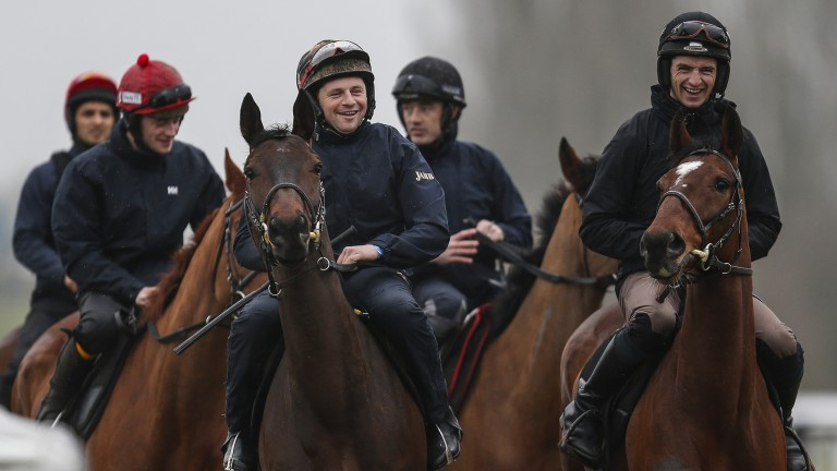 All for a laugh: Patrick Mullins (right) shares a joke with work-rider Sonny Carey as the Mullins string make their way on to the gallops at the course