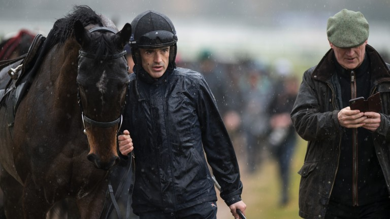 Wet workout: Ruby Walsh leads Benie Des Dieux off the gallops as Willie Mullins prepares his string on a rainy morning at Prestbury Park