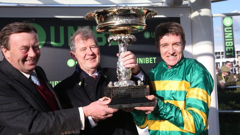 Champion trio: trainer Nicky Henderson (left), owner JP McManus and rider Barry Geraghty with the Champion Hurdle trophy after Buveur D'Air's success