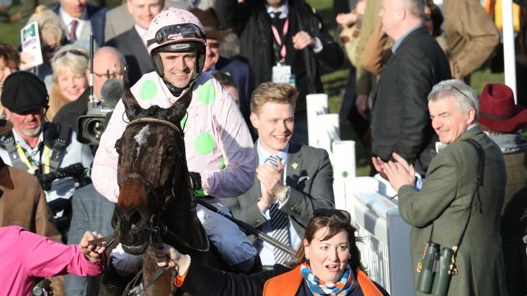 Ruby Walsh is led in after Benie Des Dieux landed the Mares' Hurdle