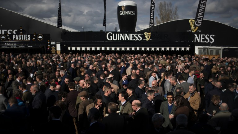 It's festival time: the crowds are starting to build in the Guinness village as the sun shines on day one