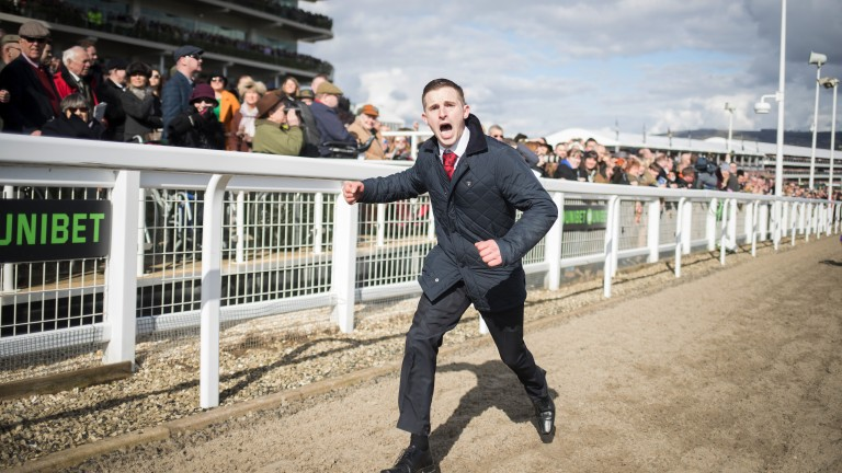 Come on my son: Kalashnikov's groom Seamus Flaherty roars on his horse up the hill in the Supreme Novices'