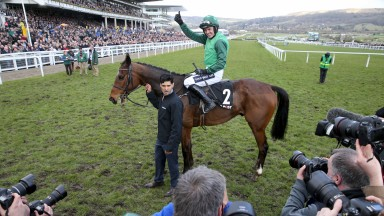 He's underway: Ruby Walsh gives the thumbs-up to the cameras having got off the mark for the 2018 festival thanks to a scintillating display from Footpad in the Racing Post Arkle