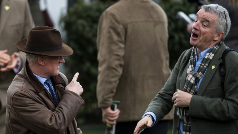 Gotcha there Michael! Gigginstown House Stud owner Michael O'Leary, whose Petit Mouchoir was third, congratulates winning trainer Willie Mullins after the victory of Footpad in the Racing Post Arkle