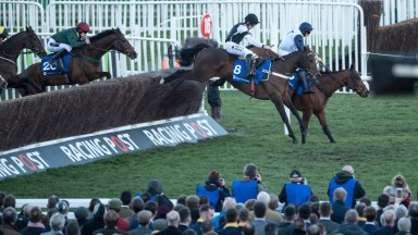 The winner Mister Whitaker (20) follows Rather Be (8) over the last fence in the 2m 4f handicap chaseCheltenham 13.3.18 Pic: Edward Whitaker