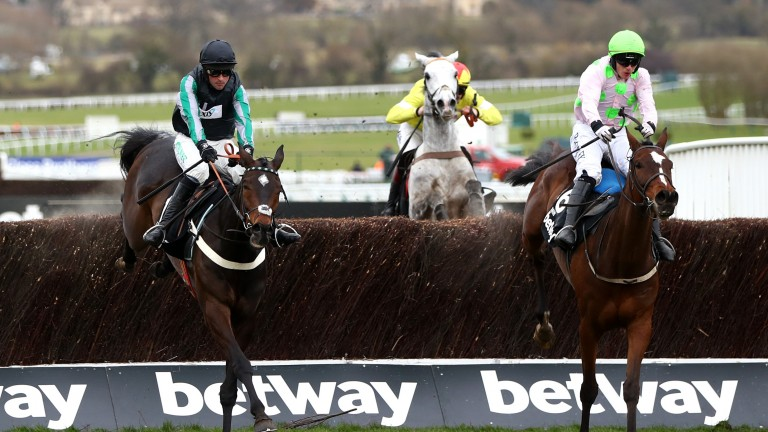 Altior (left) jumps the final fence alongside Min