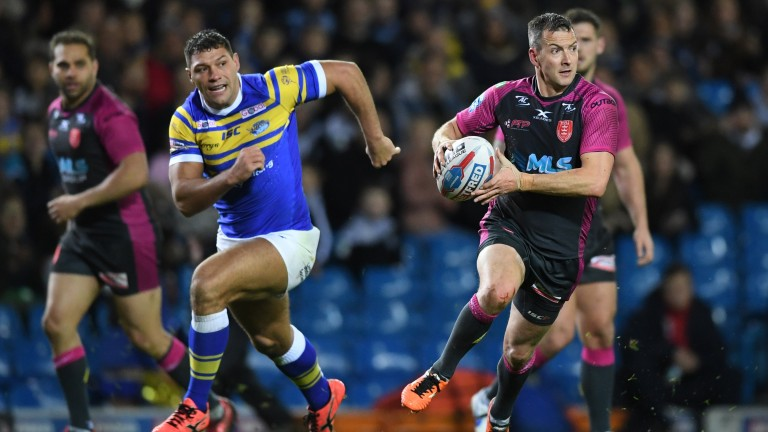 Hull KR ace Danny McGuire (right) breaks away from Leeds' Ryan Hall last month