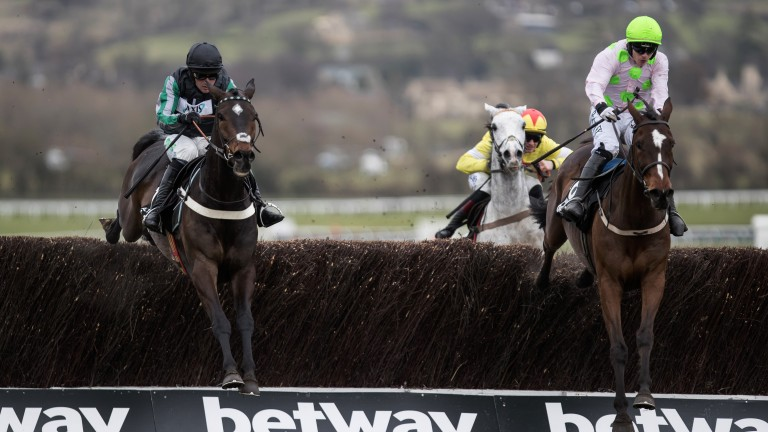 Ready to pounce: Altior (left) and Nico de Boinville jump the final fence alongside Min and Paul Townend in the Betway Queen Mother Champion Chase