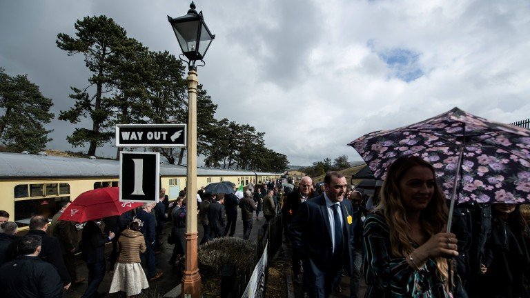 Ready for racing: racegoers disembark from the steam engine at Cheltenham racecourse station