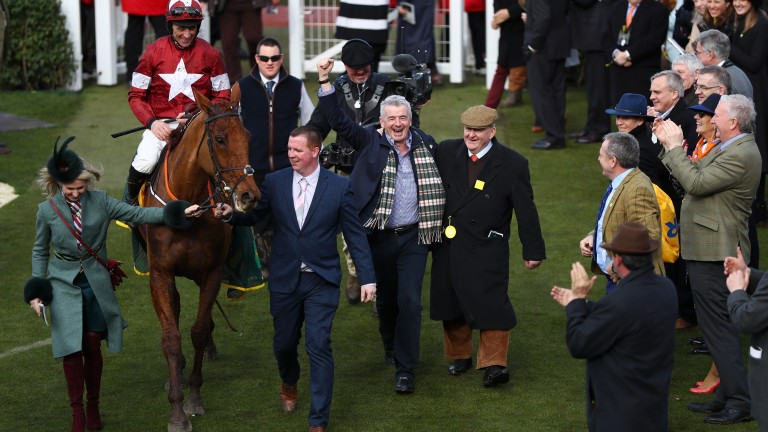 Balko Des Flos ridden by Davy Russell is lead in the the winners enclosure by Michael O'Leary after victory in the Ryanair Chase.