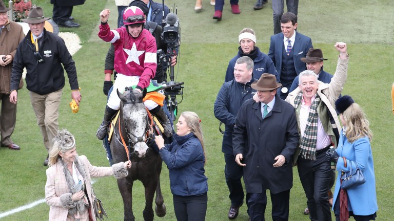 Michael O'Leary punches the air as the Farclas camp enter the Cheltenham's winner's enclosure