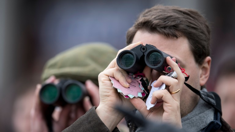 Racegoers study the action