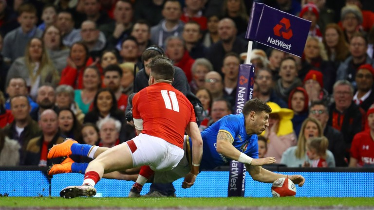 Italy full-back Matteo Minozzi scores in the corner against Wales