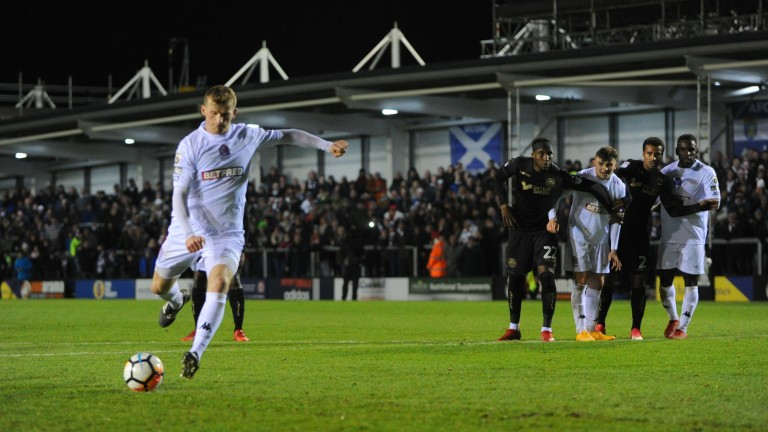 Danny Rowe of AFC Fylde scored an FA Cup penalty against Wigan