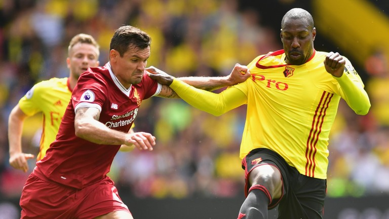 Dejan Lovren of Liverpool and Stefano Okaka of Watford during the first meeting this season