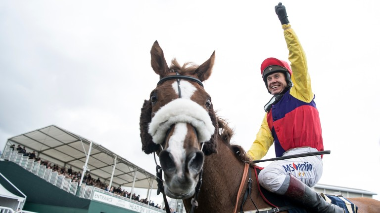 Richard Johnson has his arm aloft in triumph after winning the Gold Cup on Native River