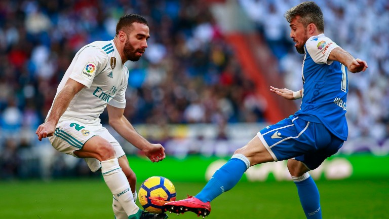 Deportivo's Luisinho Correia (right) battles Daniel Carvajal of Real Madrid