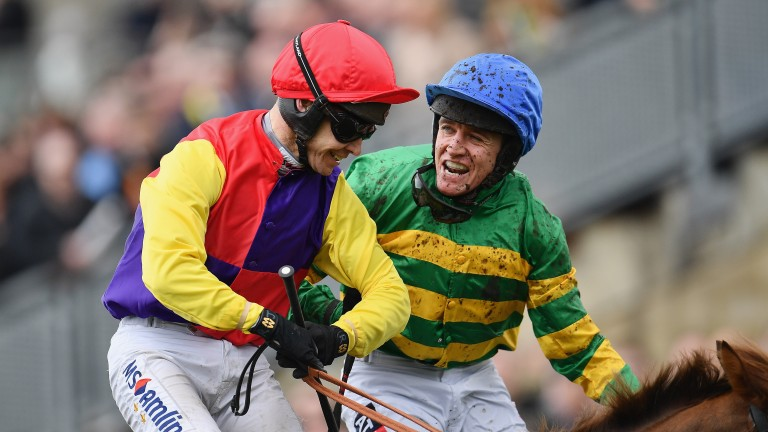 Barry Geraghty on Anibale Fly (right) congratulates Richard Johnson after his Gold Cup success on Native River