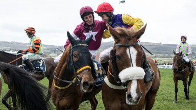 Native River (Richard Johnson) is congratulated by Sean Flanagan after winning the Gold CupCheltenham 16.3.18 Pic: Edward Whitaker