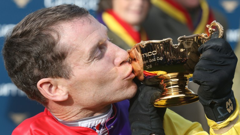 Richard Johnson kisses the Gold Cup, his second victory in the race having previously won it in 2000 with Looks Like Trouble