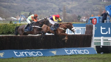Native River (right) and Might Bite battle it out for Gold Cup glory