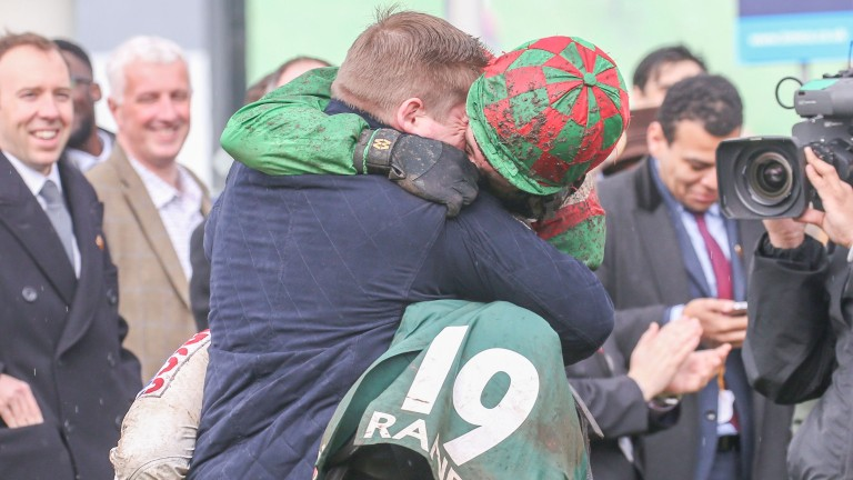 Jockey Harry Skelton embraces his brother Dan, trainer of County Hurdle winner Mohaayed – who was ridden by Harry's partner Bridget Andrews