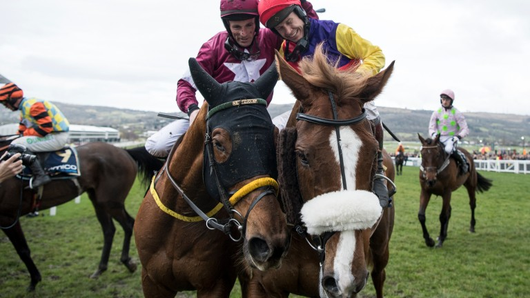 Sean Flanagan, riding Road To Respect, congratulates Richard Johnson on his Gold Cup victory with Native River