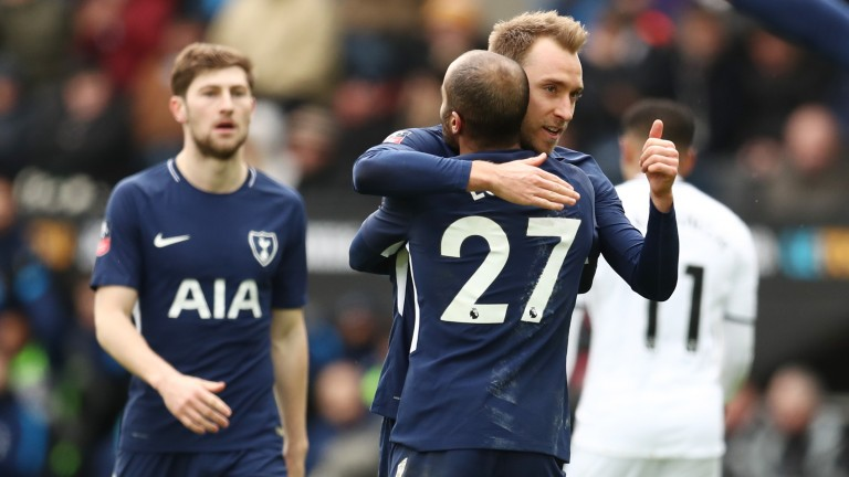 Christian Eriksen of Tottenham Hotspur celebrates with teammate Lucas Moura