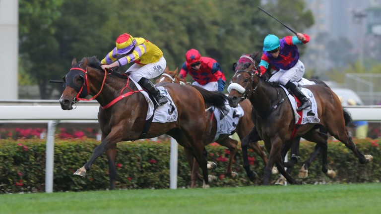 Ryan Moore drives Ping Hai Star clear of Singapore Sling in the BMW Hong Kong Derby