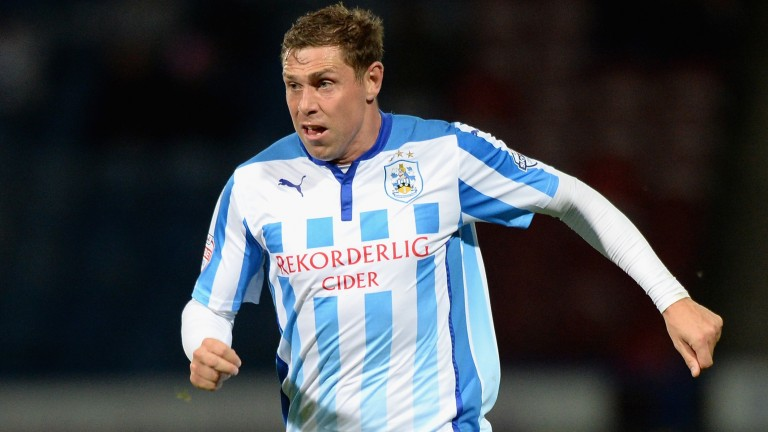 Former Huddersfield striker Grant Holt is now player-coach at Barrow