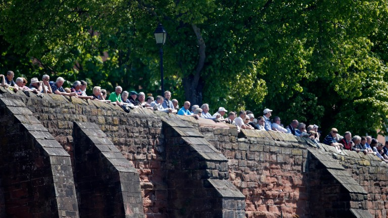 Crowds line the walls to watch the racing at Chester's massively popular May meeting