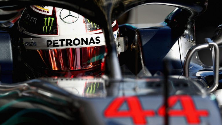 Lewis Hamilton peers out from his Mercedes during pre-season testing