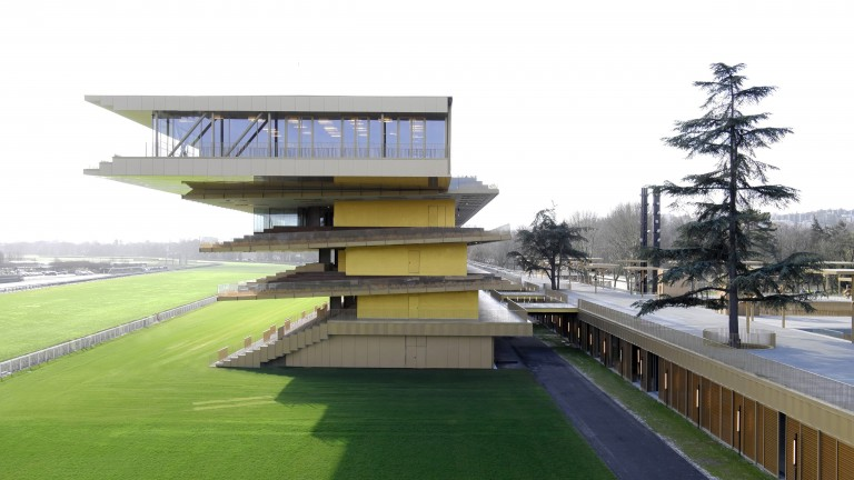 "Dominque Perrault's grandstand is designed to ""lean in"" to the action on the track"