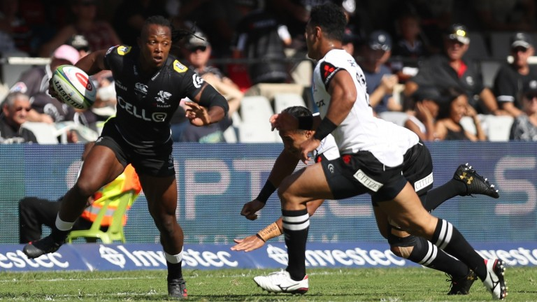 Sharks wing Sbu Nkosi evades the Sunwolves' defence