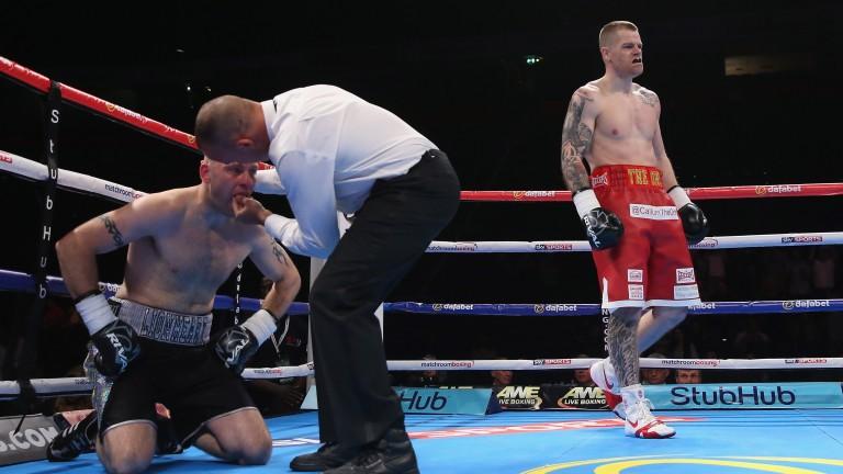 Callum Johnson knocks down Richard Horton