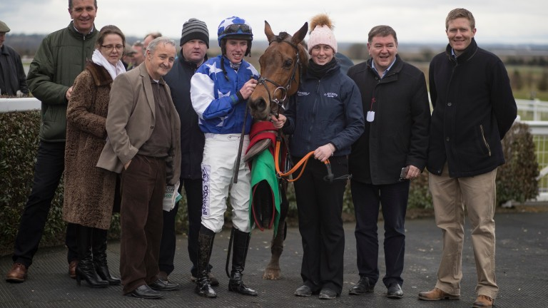 Celebration time: connections of Cartwright are all smiles after his success in the Listed novice hurdle