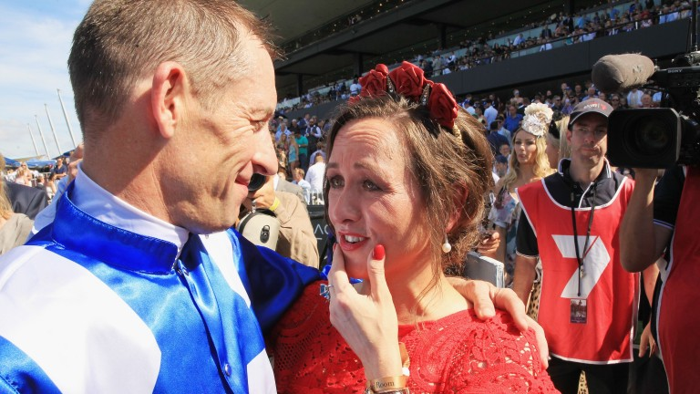 Hugh Bowman hugs wife Christine after he partnered Winx to victory in the George Ryder Stakes at Rosehill