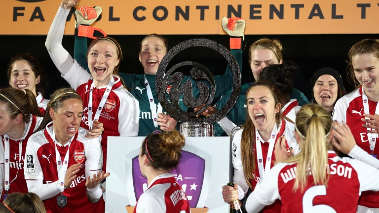 Arsenal celebrate with the WSL Continental Cup trophy