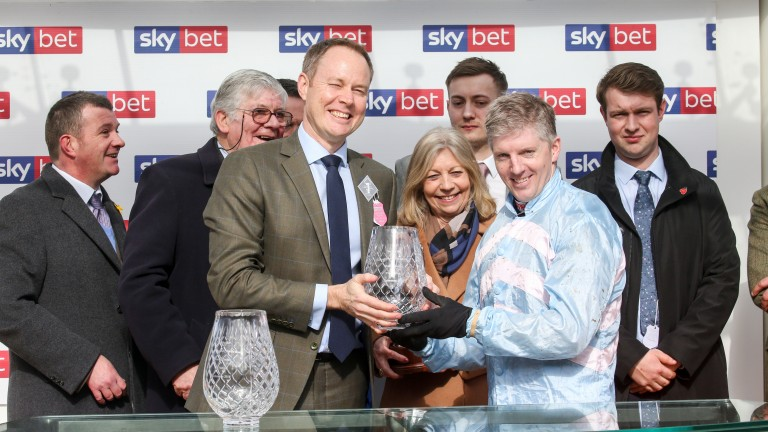 Sky Bet chief executive Richard Flint presents the trophies for this year's Supreme Novices' Hurdle