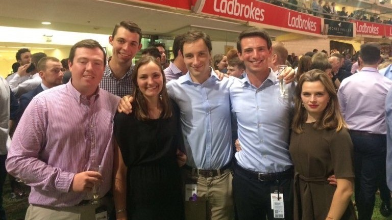 Tim Donworth (second right): pictured enjoying a day out with fellow Flying Start colleagues at Moonee Valley