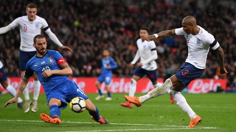 England's Ashley shoots against Italy