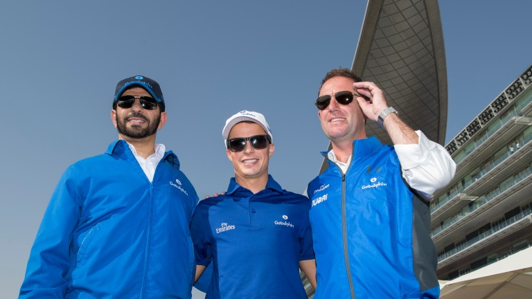 Boys in blue: Saeed Bin Suroor (left), William Buick (middle) and Charlie Appleby pose for the cameras